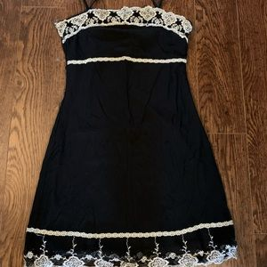 Black mini dress with white embroidered trim